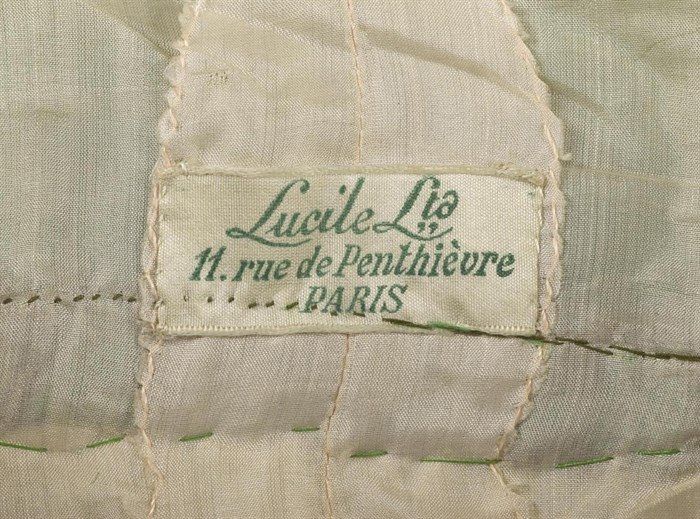 Label from an item of clothing made by Maison Lucile's Paris business.